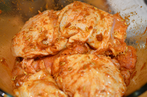spiced chicken - thighs marinating